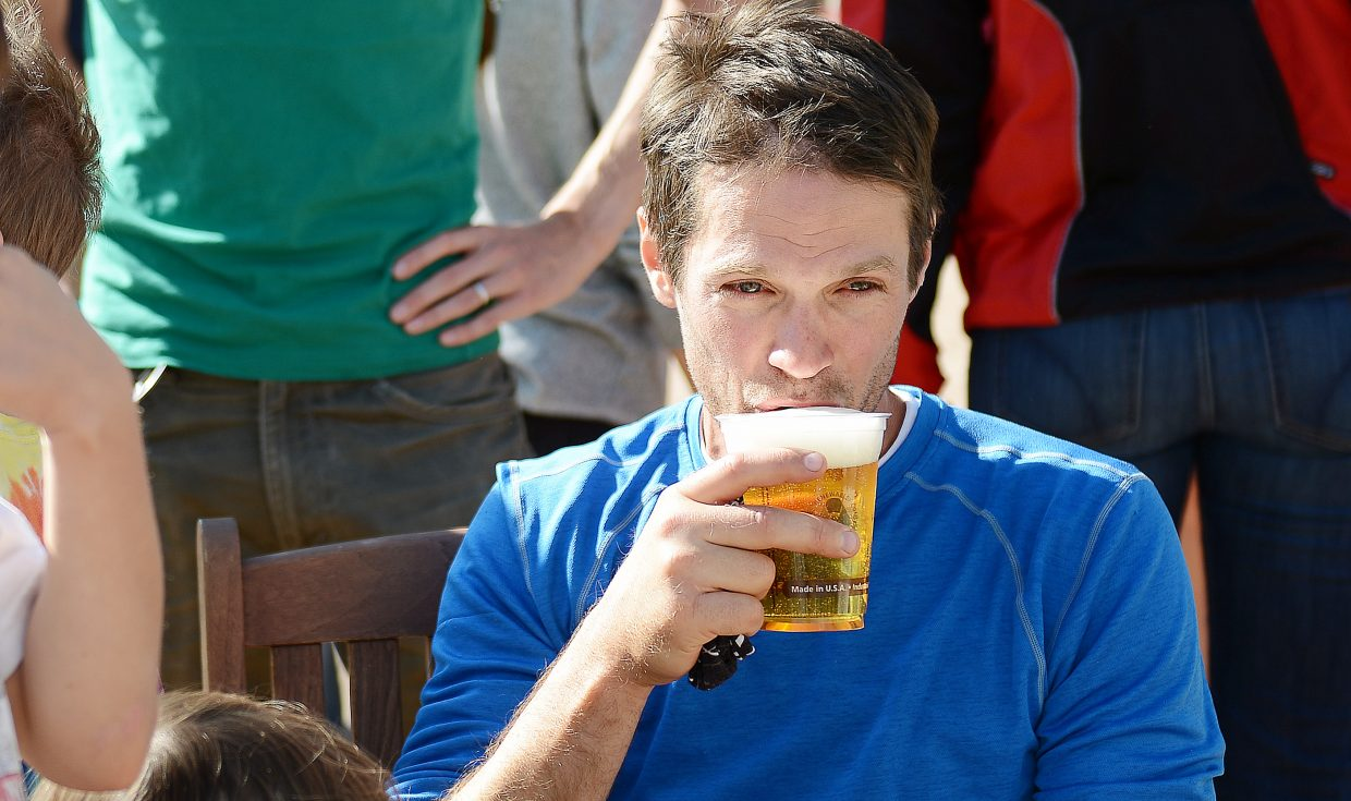 Run, Rabbit Run 100-mile finisher John Knotts sips a beer moments after finishing his race.