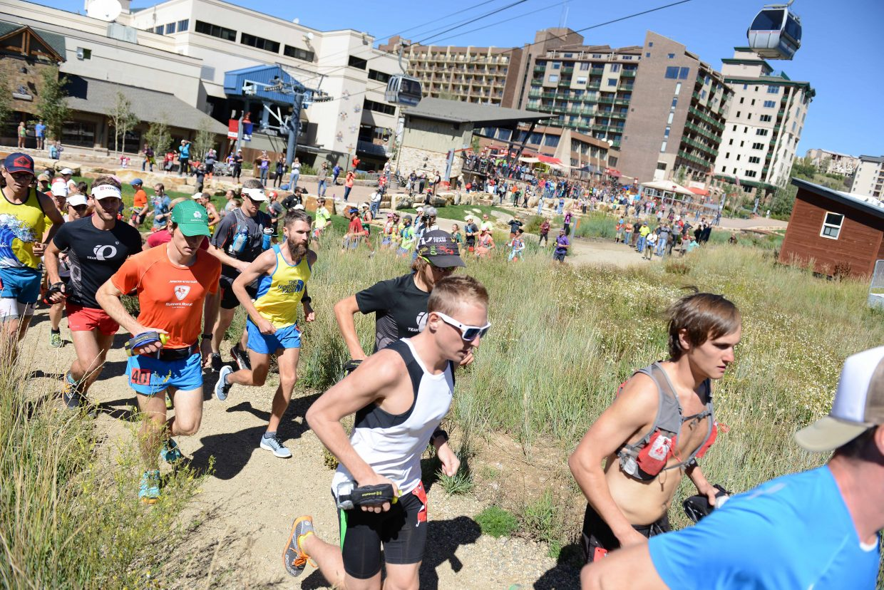 Avery Collins, in white, and other runners in the elite hare division of the Run, Rabbit Run 100-mile trail ultramarathon head out from the starting line at the base of Steamboat Resort.