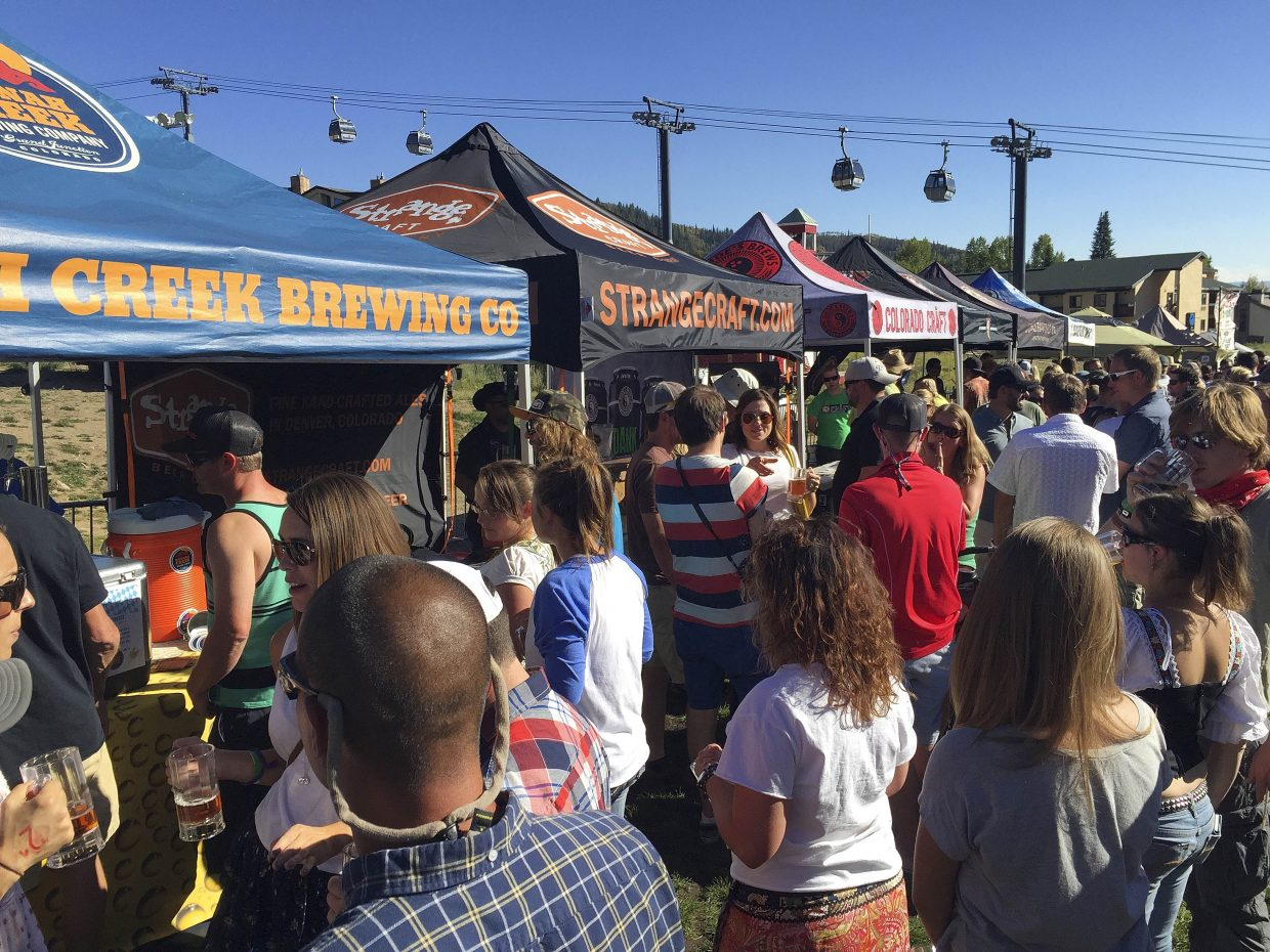People line up for beer at Steamboat OktoberWest on Saturday.