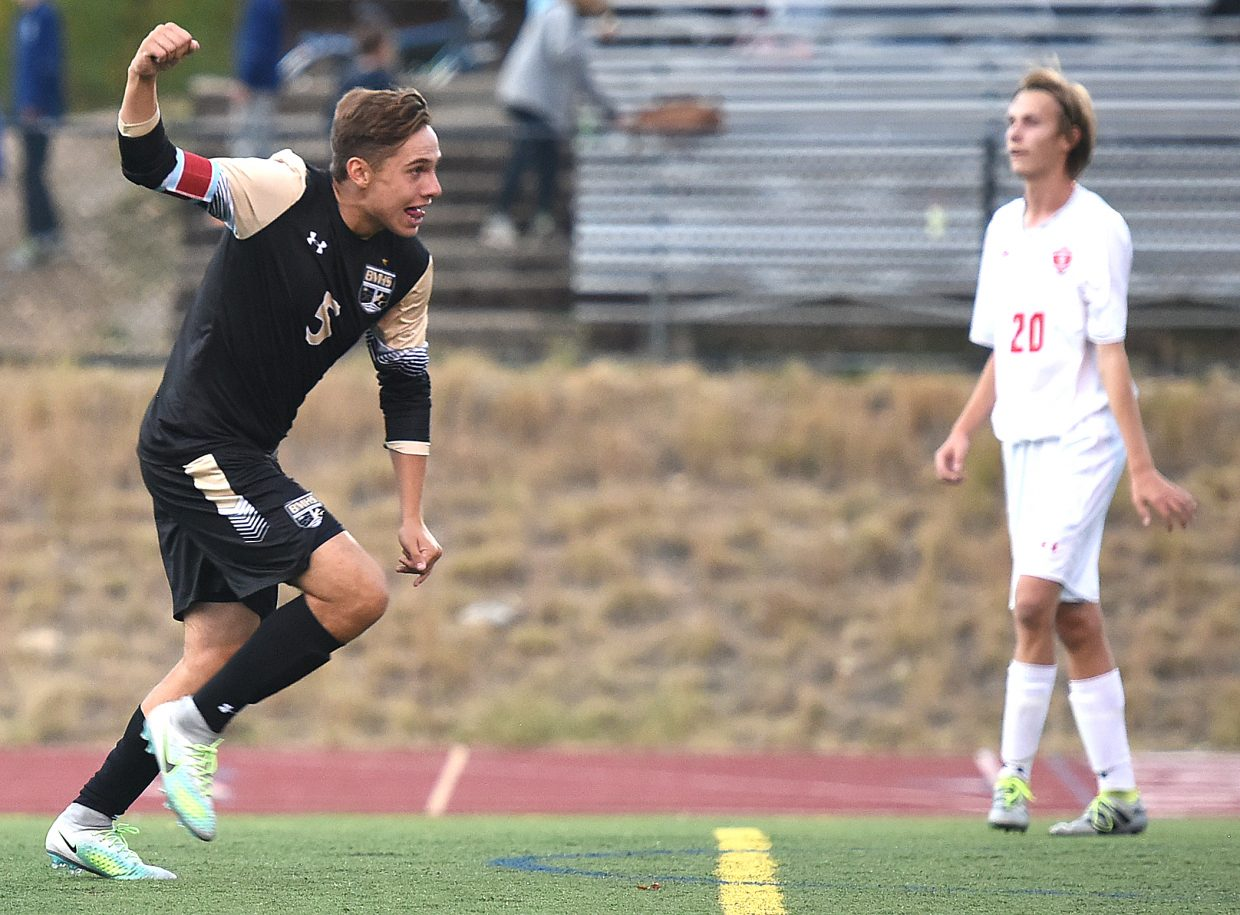 Battle Mountain's Miles Joersz celebrates after putting away a corner kick to give his team a 1-0 lead on the road Tuesday in Steamboat Springs. The Huskies went on to win, 3-0.