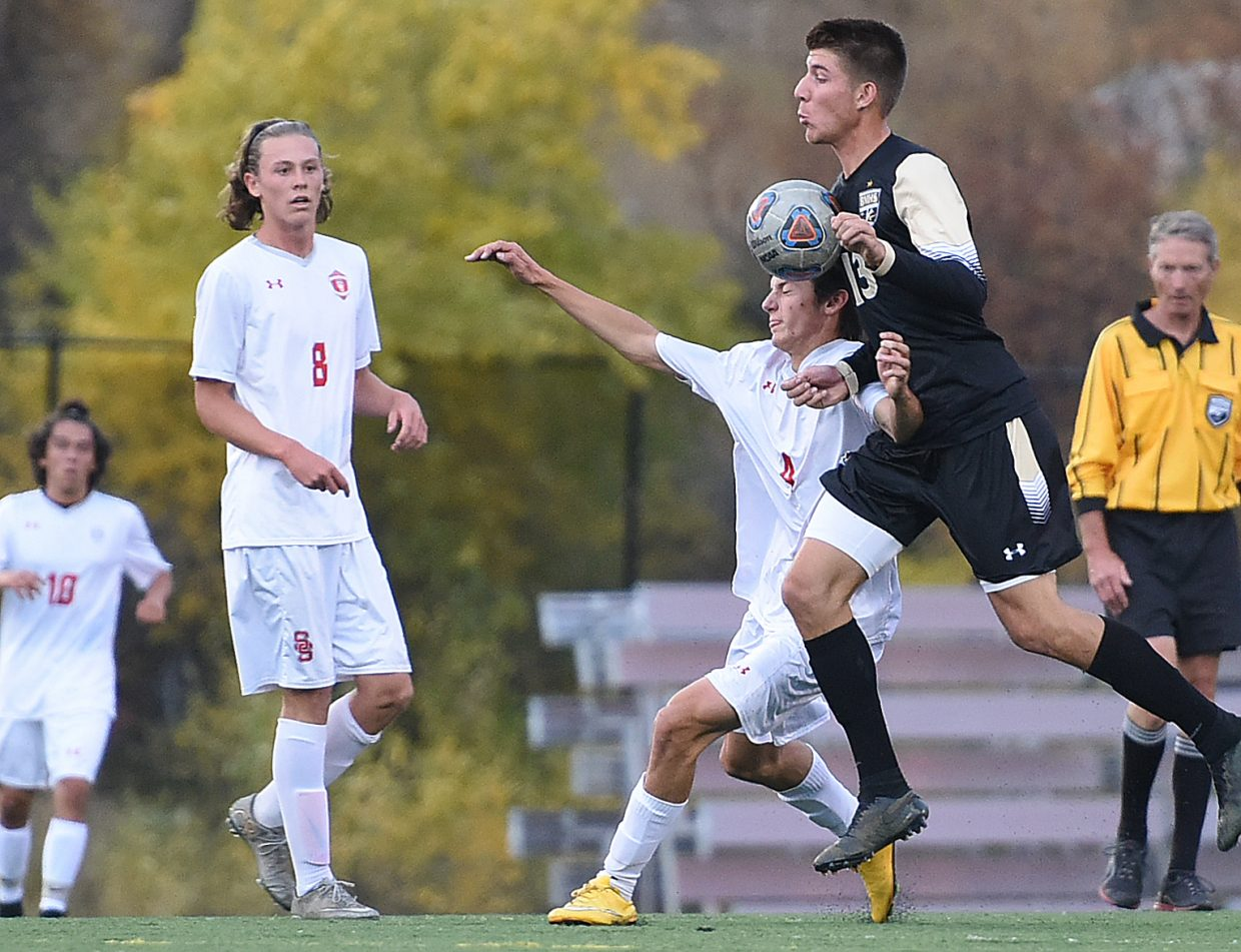 Battle Mountain's Creek Kamby fights through Steamboat's Will McConnell on Tuesday as the Huskies beat Steamboat, 3-0. The result drops the Sailors from the top of the league and into a three-way tie for first.