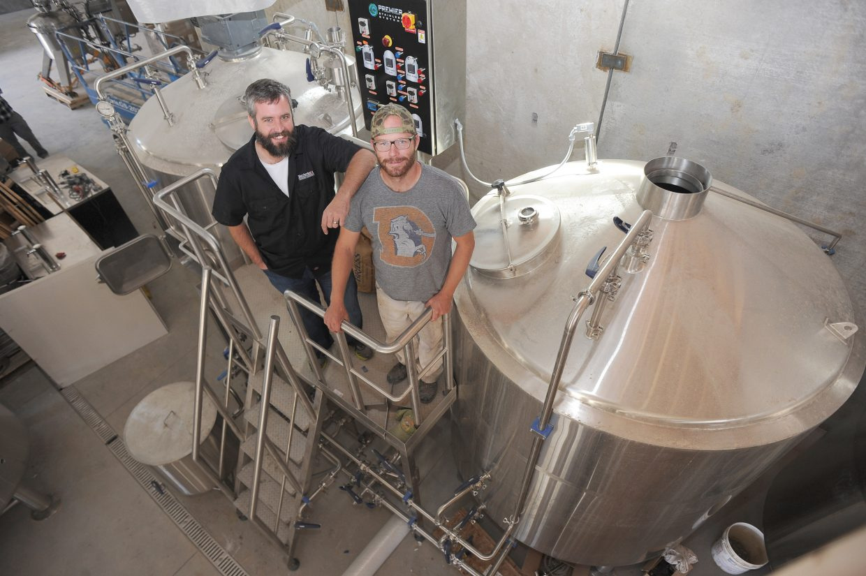 Butcherknife Brewing owners Nate Johansing, front, and Mark Fitzgerald stand inside the company's new facilities on Elk River Road. The building, which still is under construction, will house Butcherknife's operations and a tasting room.