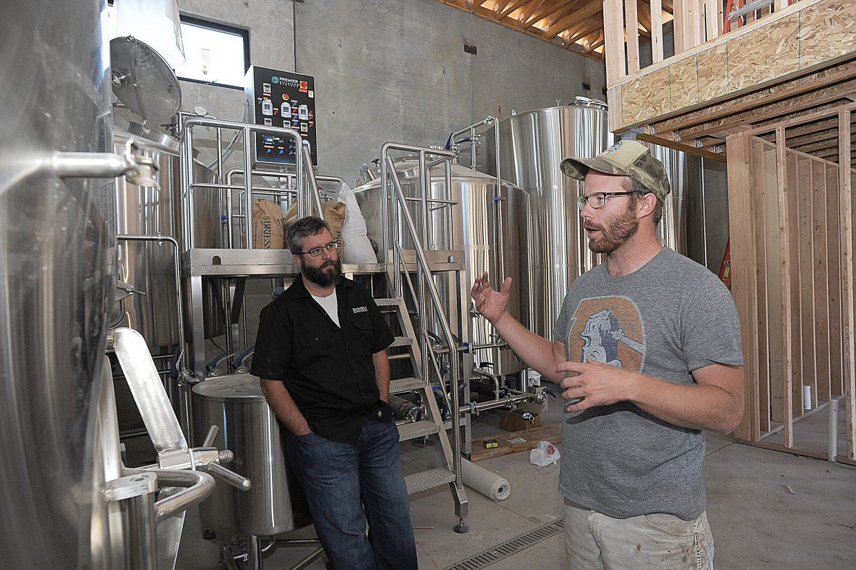 Butcherknife Brewing owners Nate Johansing, front, and Mark Fitzgerald talk about the company's operations in it's new facilities on Elk River Road. The building, which is still under construction, will house Butcherknife's operations and a tasting room.