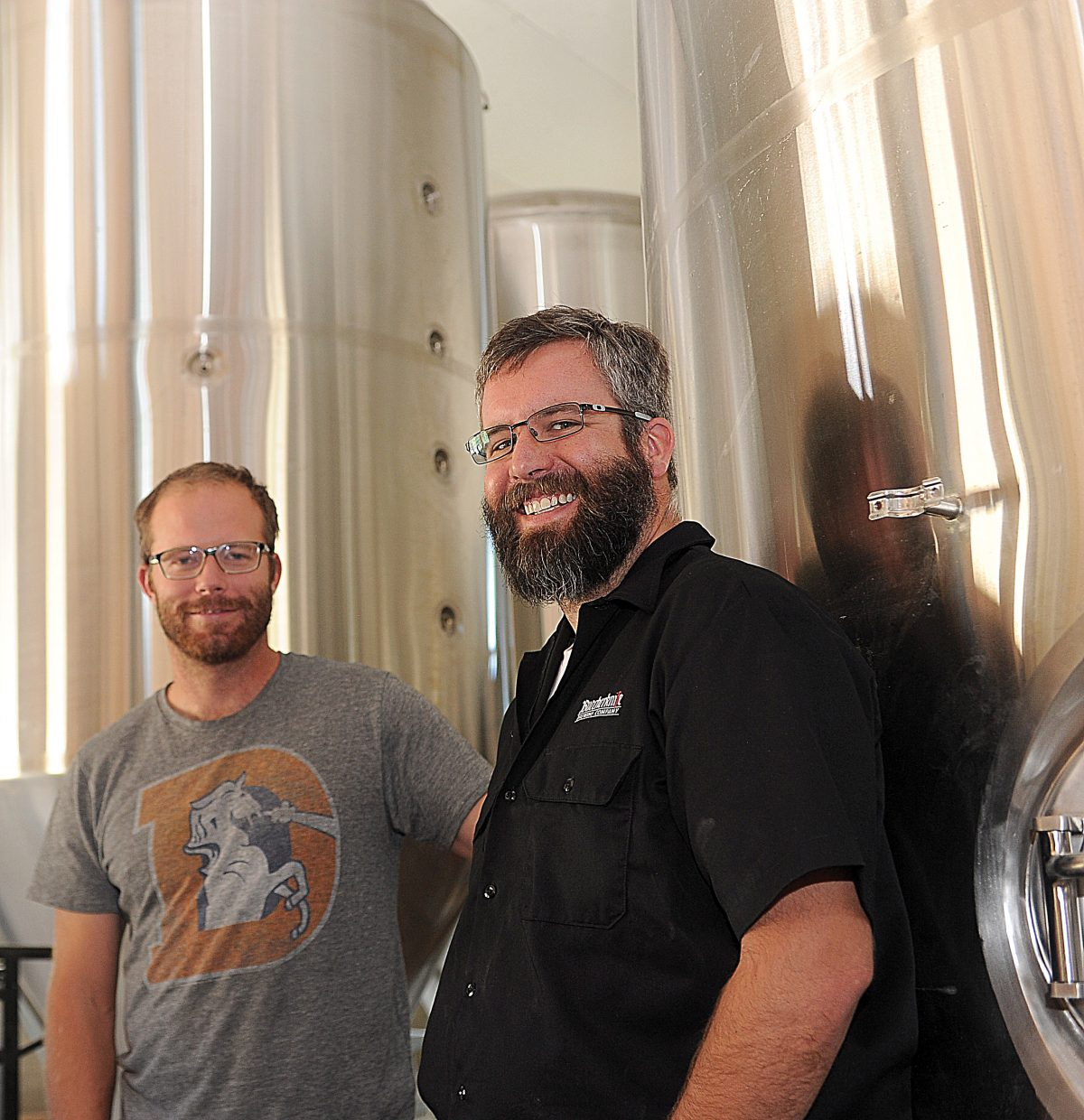 Butcherknife Brewing owners Nate Johansing, left, and Mark Fitzgerald stand inside the company's new facilities on Elk River Road. The building, which is still under construction, will house Butcherknife's operations and also be home for a tasting bar.