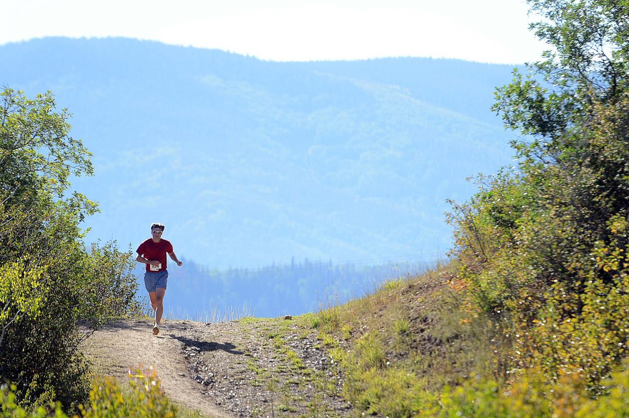 Allen Belshaw runs Saturday in the Emerald Mountain Trail Run in Steamboat Springs.