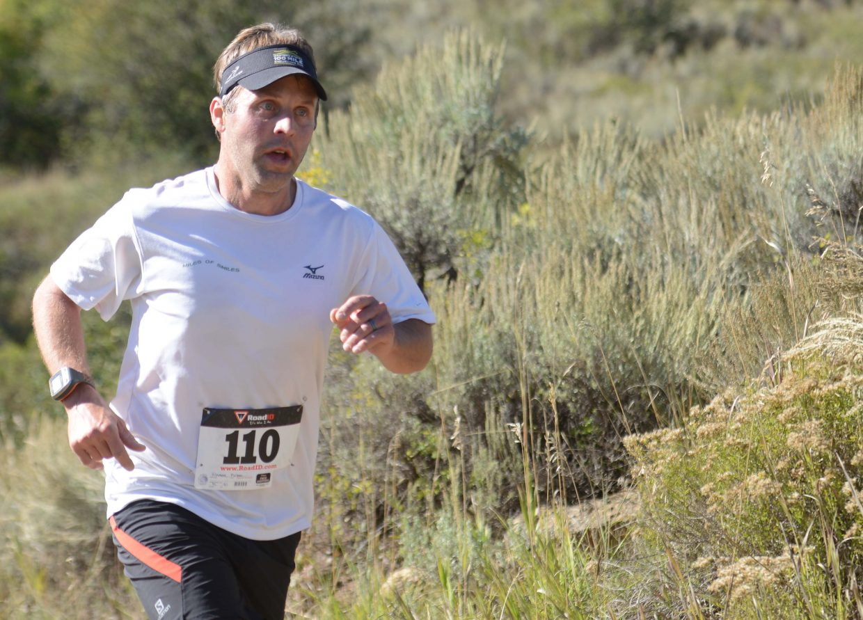 Mike Hlavacek runs Saturday in the Emerald Mountain Trail Run in Steamboat Springs.