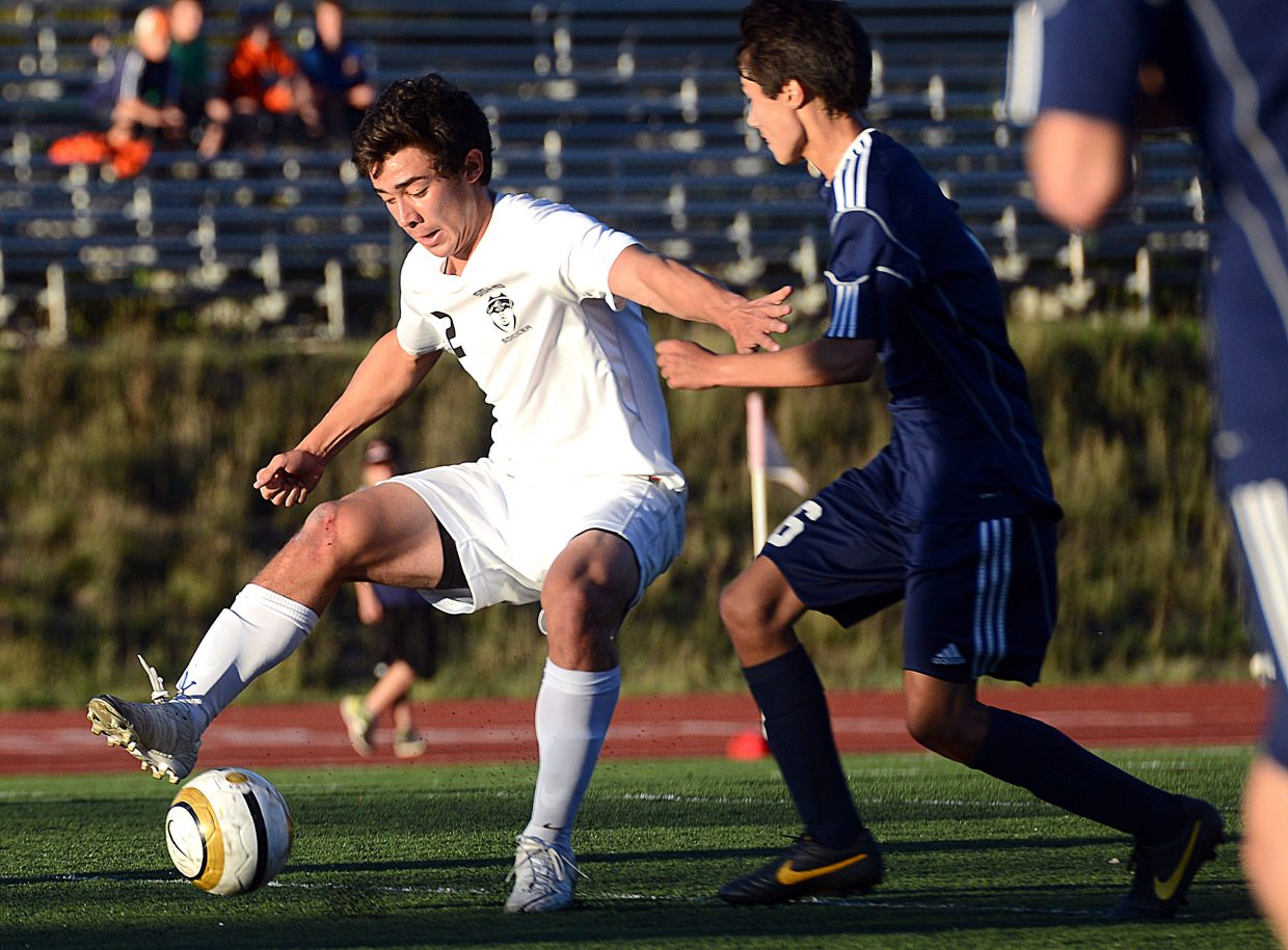 Michael Wong fights for the ball Saturday against Evergreen.