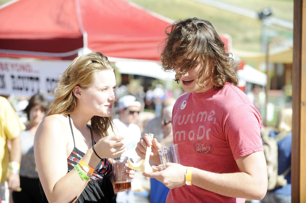 Katie Gilchrist and Jacob Gohdes, of Golden, taste a jerk brisket from Sweetwater Grill during OktoberWest on Saturday at the base of Steamboat Ski Area.