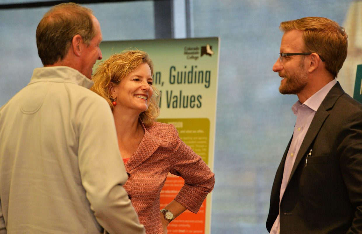 Colorado Mountain College President Dr. Carrie Besnette Hauser visits with Matt Gianneschi, chief operating officer for CMC, right, and Steamboat Springs' Jim Swiggart, left, before the start of a town hall meeting hosted by CMC on Monday afternoon.