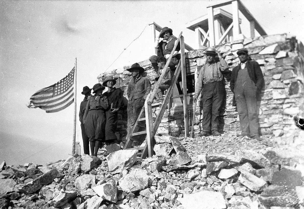 A group of hikers visited the original Hahn's Peak fire lookout in 1922. It wasn't until the 1930s that the wooden second story and catwalk were added.