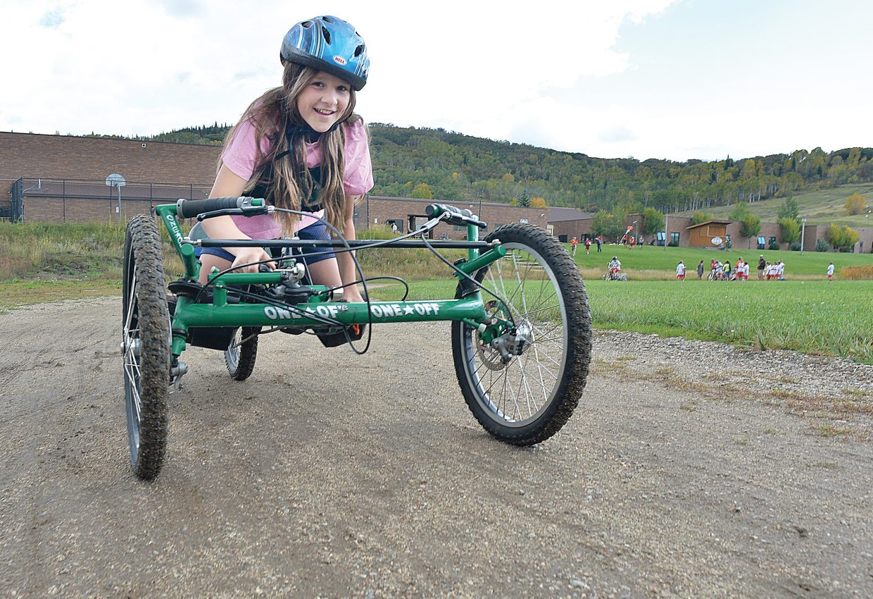 Steamboat Springs Middle School sixth-grader Josey Foote uses a One-Off Handcycle on Tuesday morning to make her way around the track during her physical education class. Steamboat Adaptive Recreational Sports brought several bicycles designed for riders with disabilities to the class so that students could try them. The idea was to give the students a feel of what it is like to use the equipment.