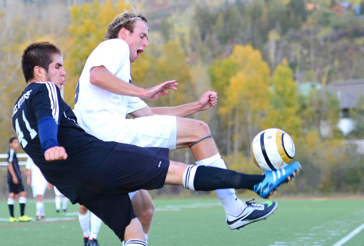 Steamboat's Nathan DePuy and Eagle Valley's Aldo Palacios battle for a ball Tuesday in Steamboat Springs.