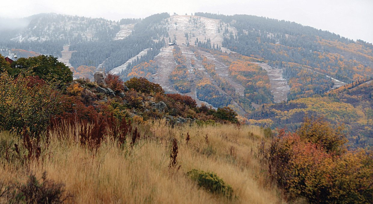 For the first time in several months, snow could be seen on the slopes of Steamboat Ski Area Friday afternoon when the clouds finally parted. The cool, wet weather that brought snow to Mount Werner is expected to hang around Saturday.