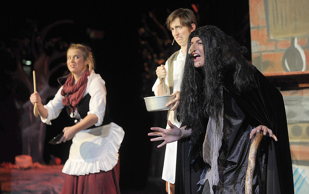 """Carly Jo Hanley plays the part of the witch in a scene with Charlie Tisch and Sara Stout while rehearsing the Steamboat Springs High School Drama Troupe's production of """"Into the Woods."""" The high school will host performances at 7 p.m. Thursday, Friday and Saturday evenings. There also will be a matinee at 2 p.m. Saturday. Tickets are on sale at All That Jazz and the high school for $10 for adults, $8 for students and $4 for small children and students with an activity pass."""