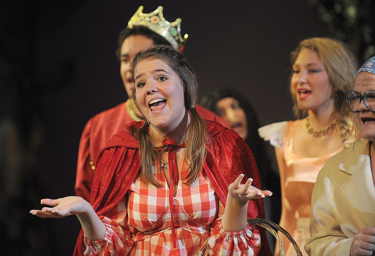 """Heather Seams plays the part of Little Red Riding Hood while rehearsing the Steamboat Springs High School Drama Troupe's production of """"Into the Woods."""""""