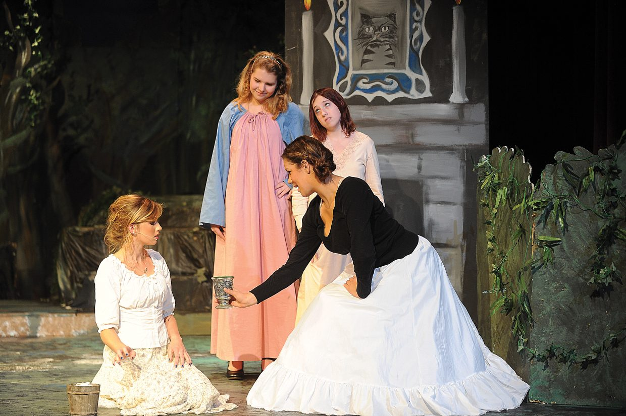 """Andie Baker, playing the part of the evil step mom, offers Cinderella (Lena Barker) more work while rehearsing a scene in """"Into the Woods."""""""