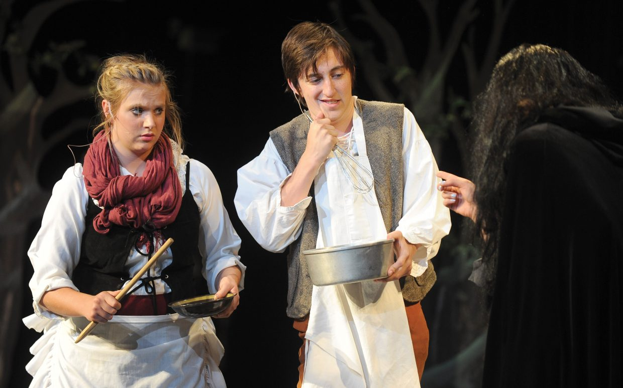 """Sara Stout plays the part of the baker's wife along with Charlie Tisch the baker and Carly Jo Hanley the witch while rehearsing for """"Into the Woods."""""""
