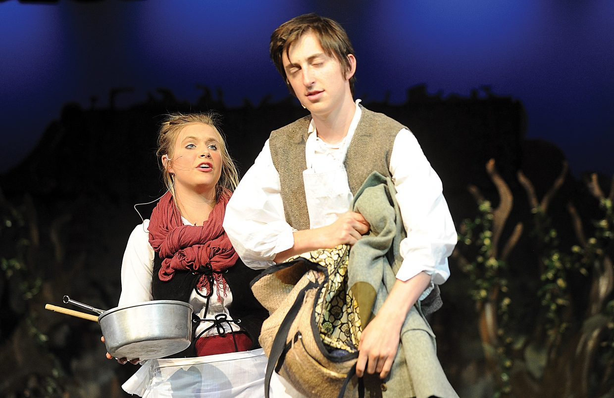 """Sara Stout plays the part of the baker's wife in a scene along with Charlie Tisch the baker while rehearsing the Steamboat Springs High School Drama Troupe's production of """"Into the Woods."""""""