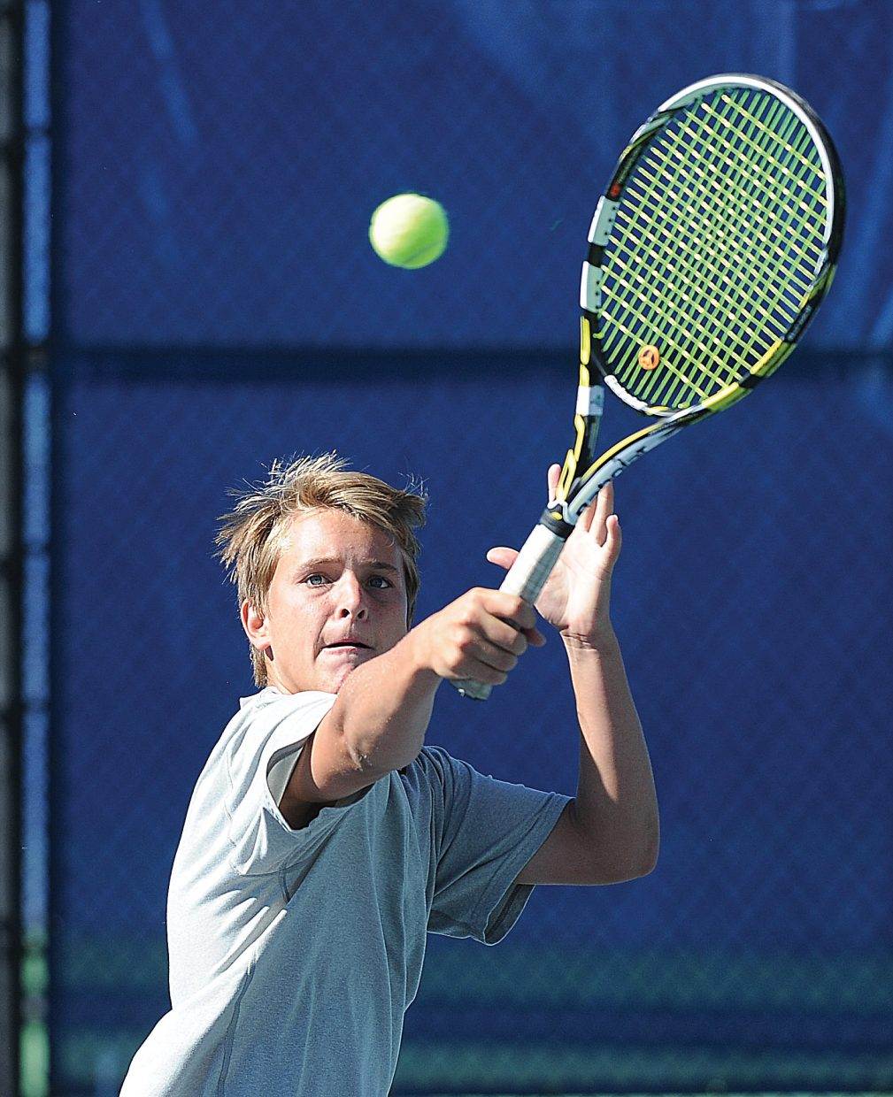 Steamboat Springs tennis player Matthew White returns a shot during a match against Vail Christian on Tuesday afternoon at the Tennis Center at Steamboat Springs. The Sailors swept the match, picking up a 7-0 victory.