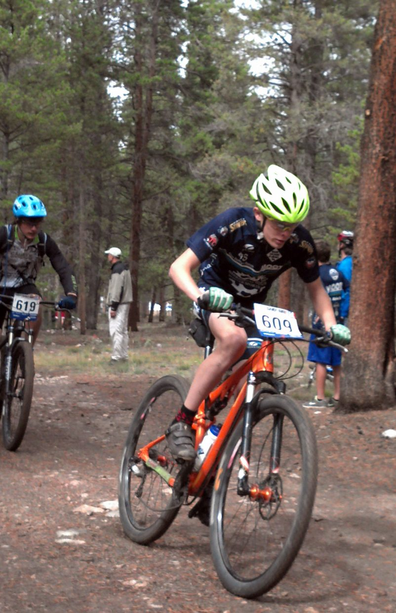 Koby Vargas rides Sunday in a high school mountain bike race. He won the sophomore boys race, surging at the finish line to claim the victory.