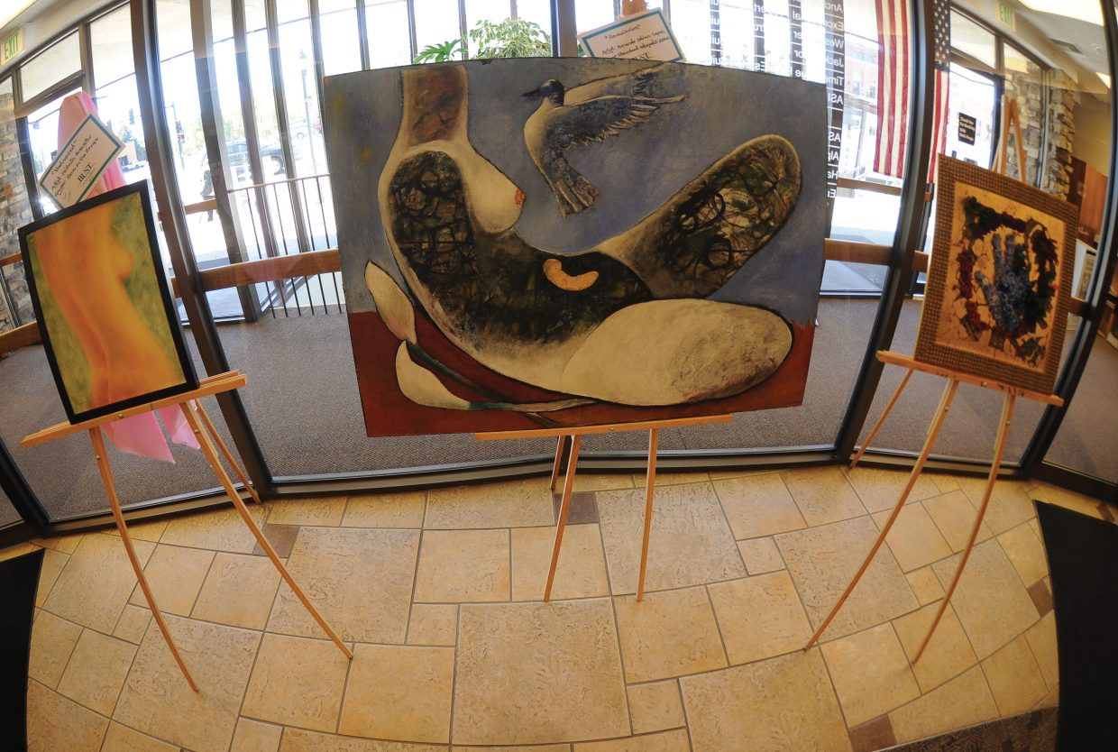 Artwork by artists Michelle Brewster, Armando Adrian-Lopez and Susan Schiesser has been displayed at Wells Fargo Bank ahead of the annual Bust of Steamboat fundraiser Friday.