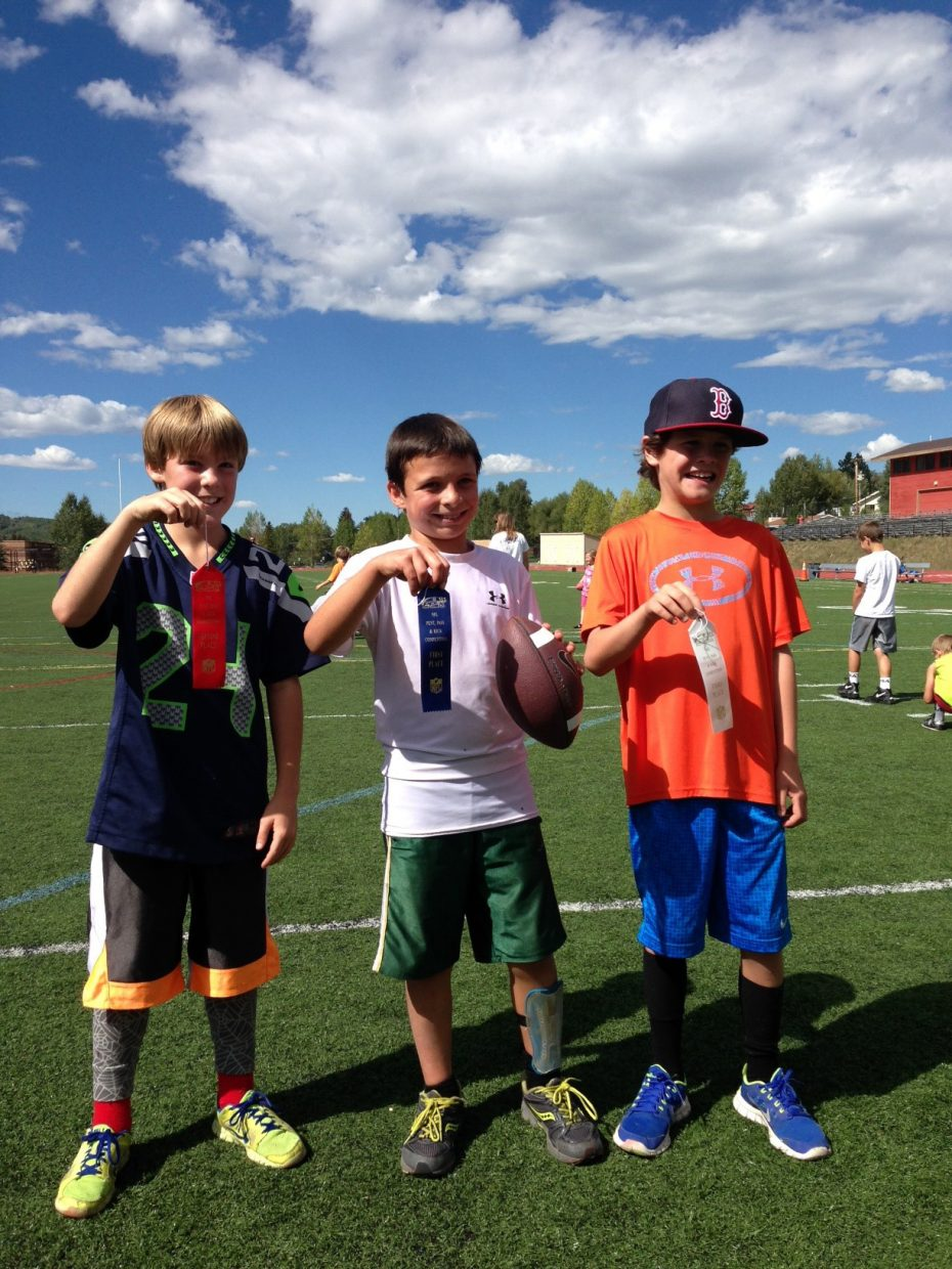 James Harbison, middle, was first, Kellen Adams, left, was second and Cade Gedeon was third in the boys 8 and 9 division of the Punt, Pass and Kick event Saturday in Steamboat Springs.