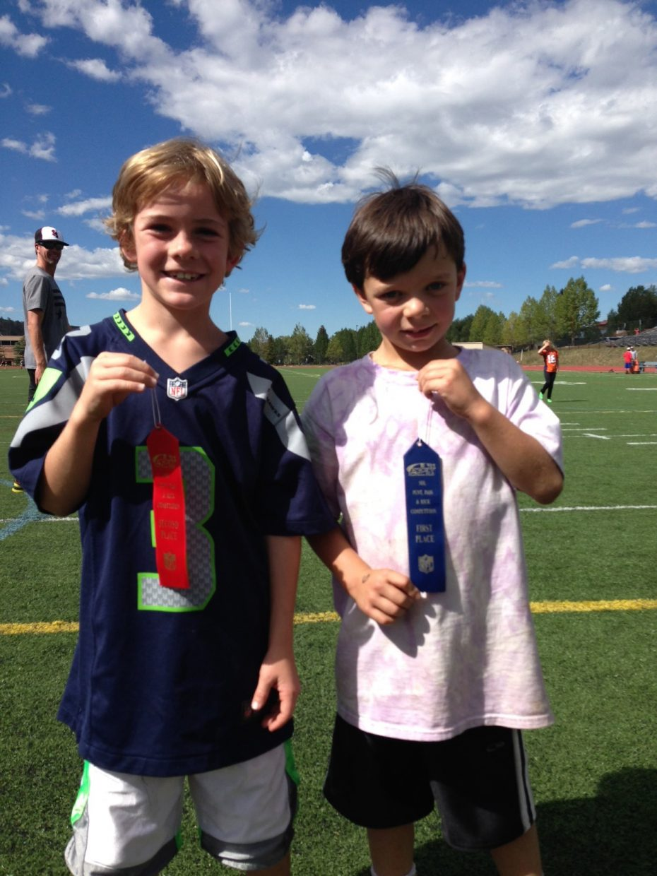 William Harbison, right, was first, and Braden Adams was second in the boys ages 6 and 7 division of the Punt, Pass and Kick event Saturday in Steamboat Springs. Keir Nykamp, not pictured, was third. Tyler Doyne won the boys ages 12 and 13 division ahead of Kieran Hahn in second and Tanner Raper in third.