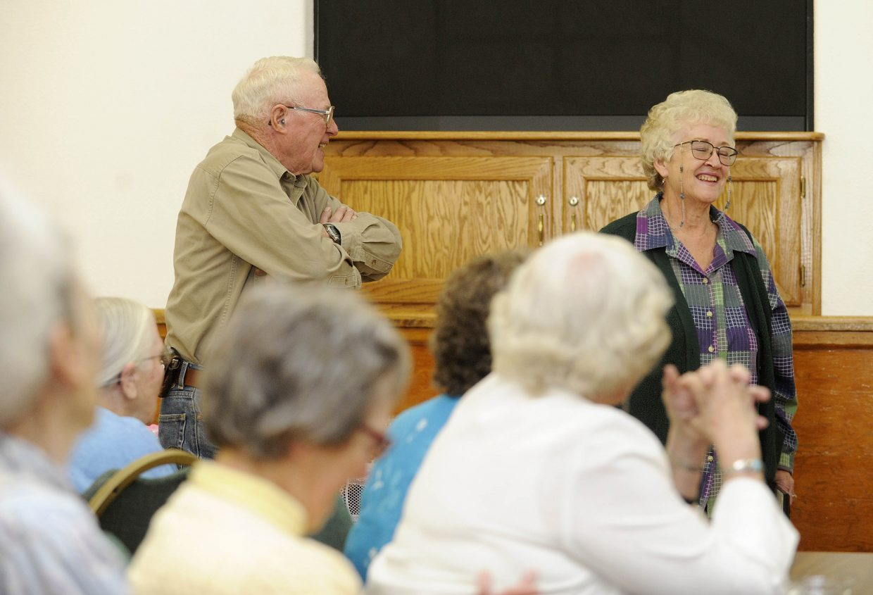 Beth and John Sundberg react as they are honored by the National Weather Service for their 41 years of volunteer weather observing from their Hayden home. They received the award Thursday at the Hayden Congregational Church.