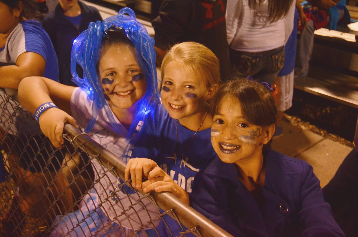 From left, 10-year-olds Reina Steele, Halle Hamilton and Karla Silva show their support of the Moffat County High School Bulldogs on Friday night during the Homecoming game against Battle Mountain. Halle is the younger sister of MCHS quarterback Matt Hamilton.