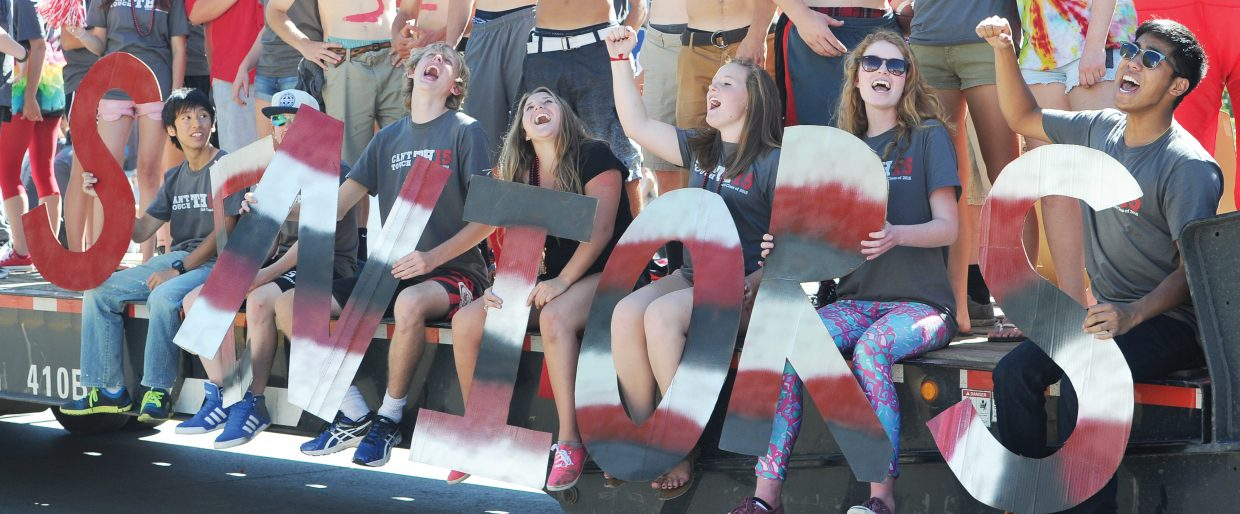Steamboat Springs High School seniors, from left, Ryoga Aoki, Ben Lingle, Erik Rudolf, Amber Finch, Hanna Haggarty, Shannon Parks and Tangmo Teharukpong show their spirit during the 2014 Homecoming Parade on Friday afternoon.