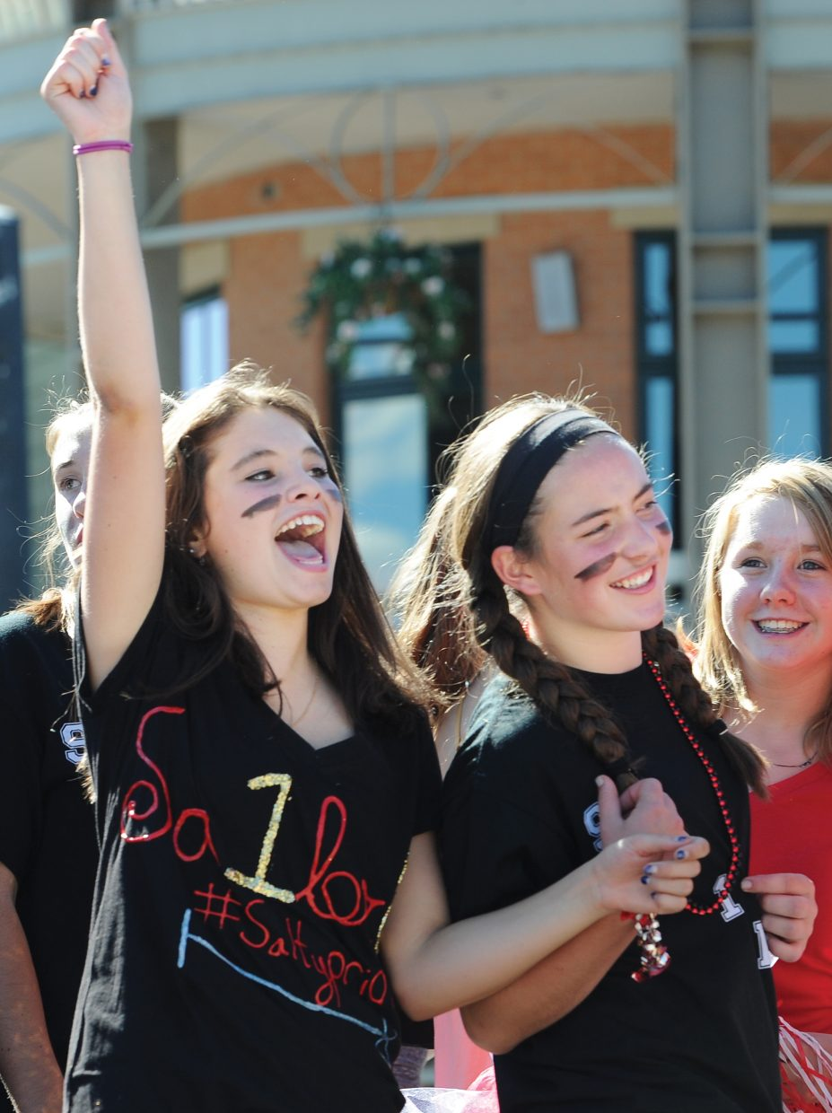 Sarah Heinke, left, and Keelan Vargas cheer during the Steamboat Springs High School Homecoming Parade on Friday afternoon on Lincoln Avenue.