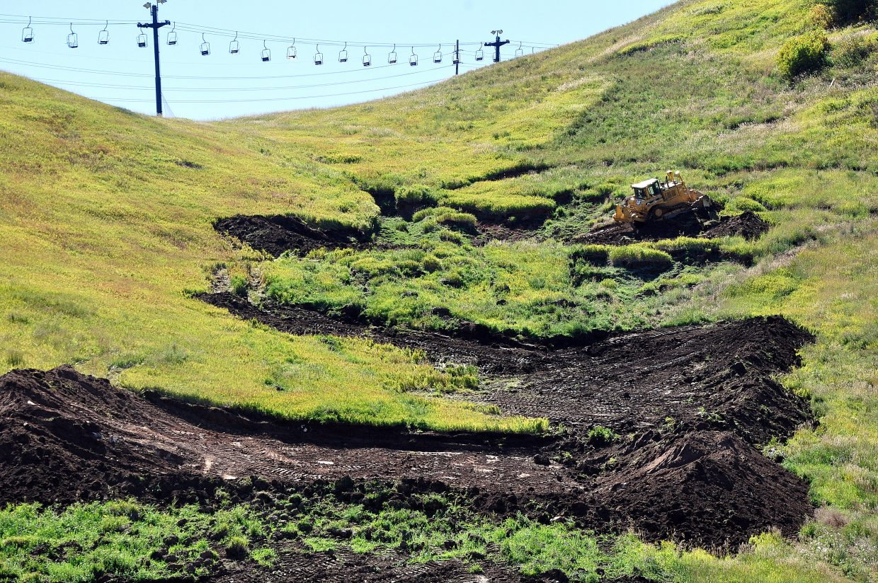 A bulldozer starts to repair the damage on Howelsen Hill that was caused by a mud slide in the spring. City Manager Deb Hinvark told the Steamboat Springs City Council earlier this month that the city is paying about $62,000 to repair the damage caused by the slide, and the cost of the repair will be paid out of a contingency fund. The work is expected to be completed before the start of the ski season.