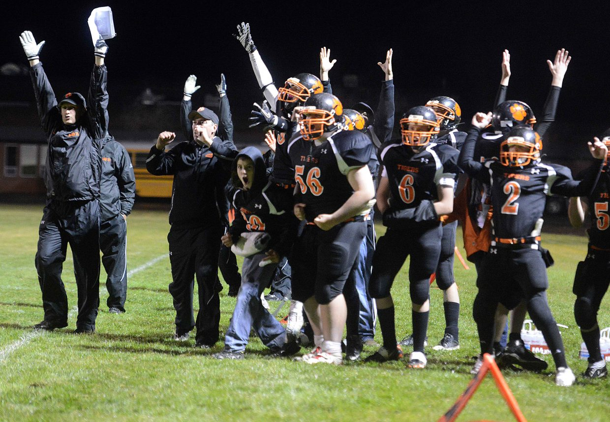 The Hayden sideline erupts after a fourth-quarter touchdown Friday against Rangely.