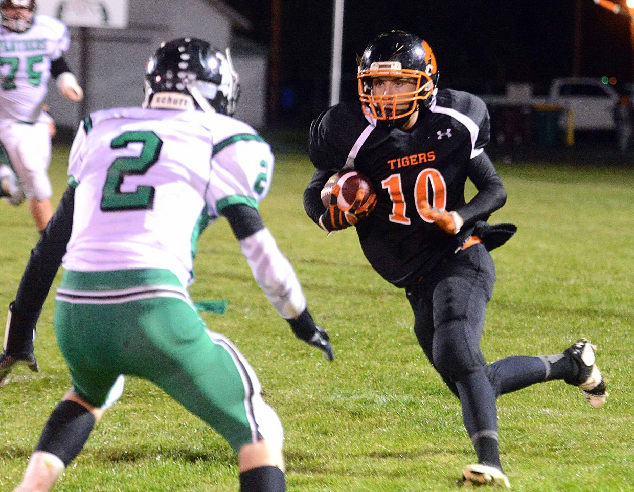 Hayden's Sam Skof runs after catching a pass Friday night against Rangely.