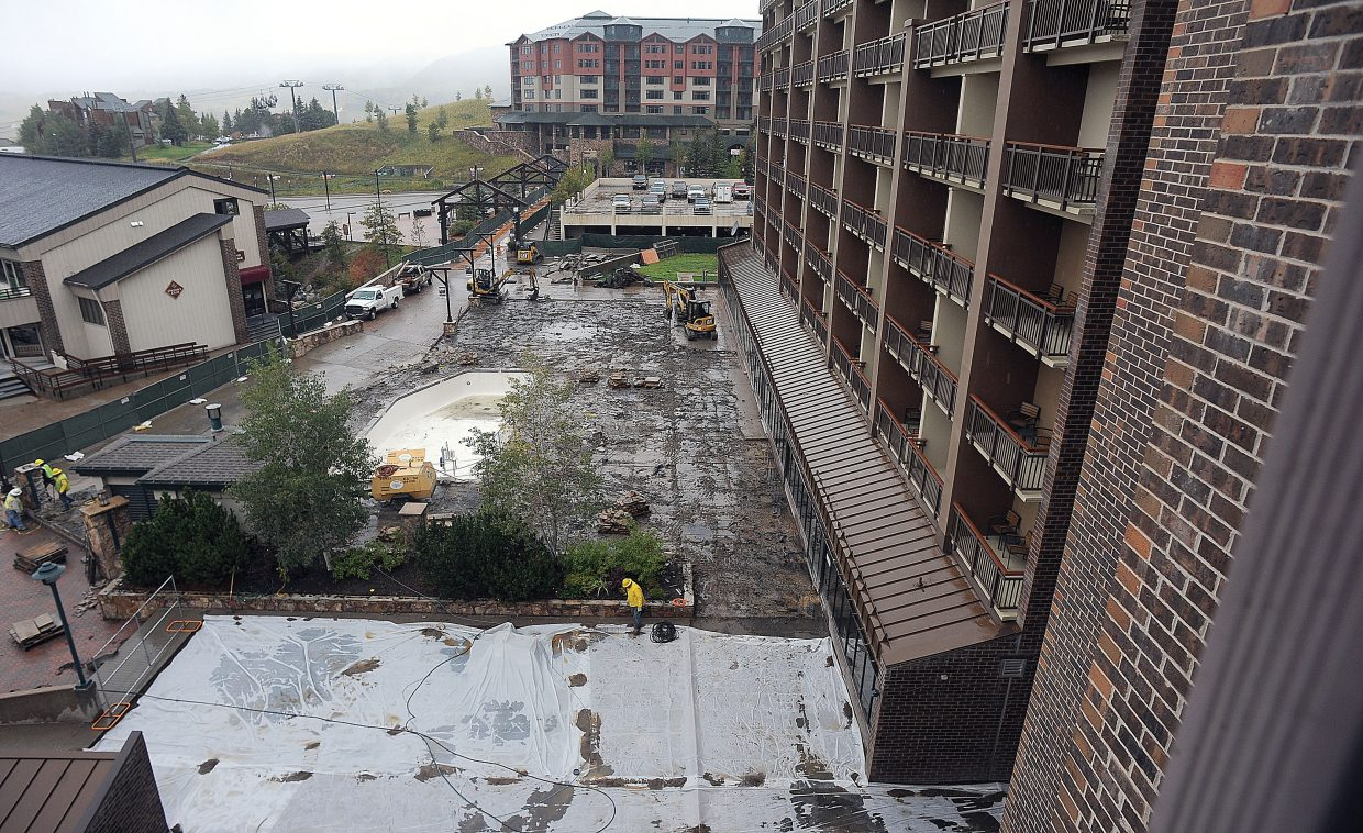 Construction crews worked through the rain Friday afternoon on renovations at the Sheraton Steamboat Resort. Starwood Hotels and Resorts is putting more than $16 million into the Steamboat property this year, and the Sheraton should have a significant facelift complete before Christmas.