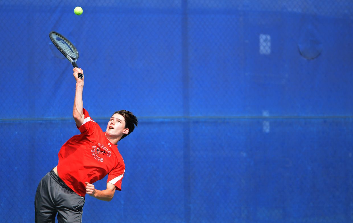 Steamboat's Willy Gunn reaches for a serve Saturday.