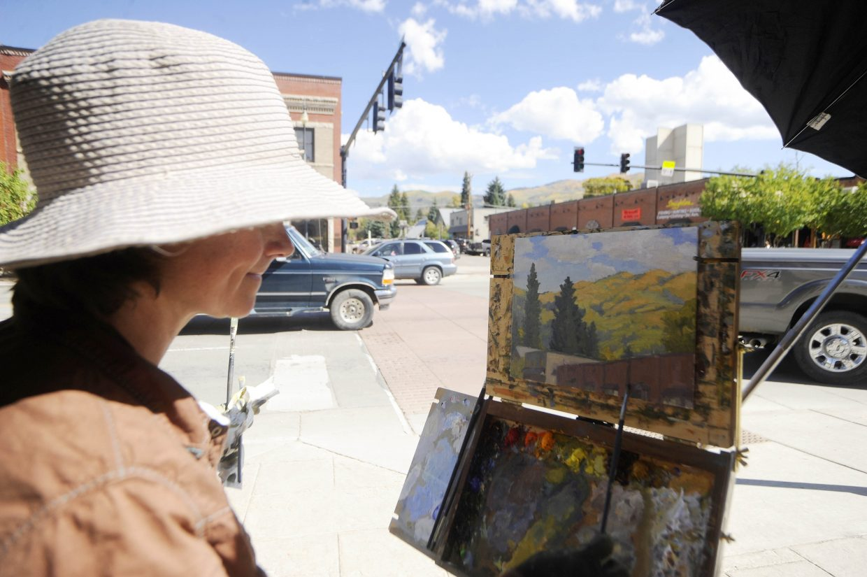 Steamboat Springs artist Chula Beauregard works on her painting at Eighth Street and Lincoln Avenue on Saturday during the Steamboat Art Museum's plein air painting Quick Draw event.