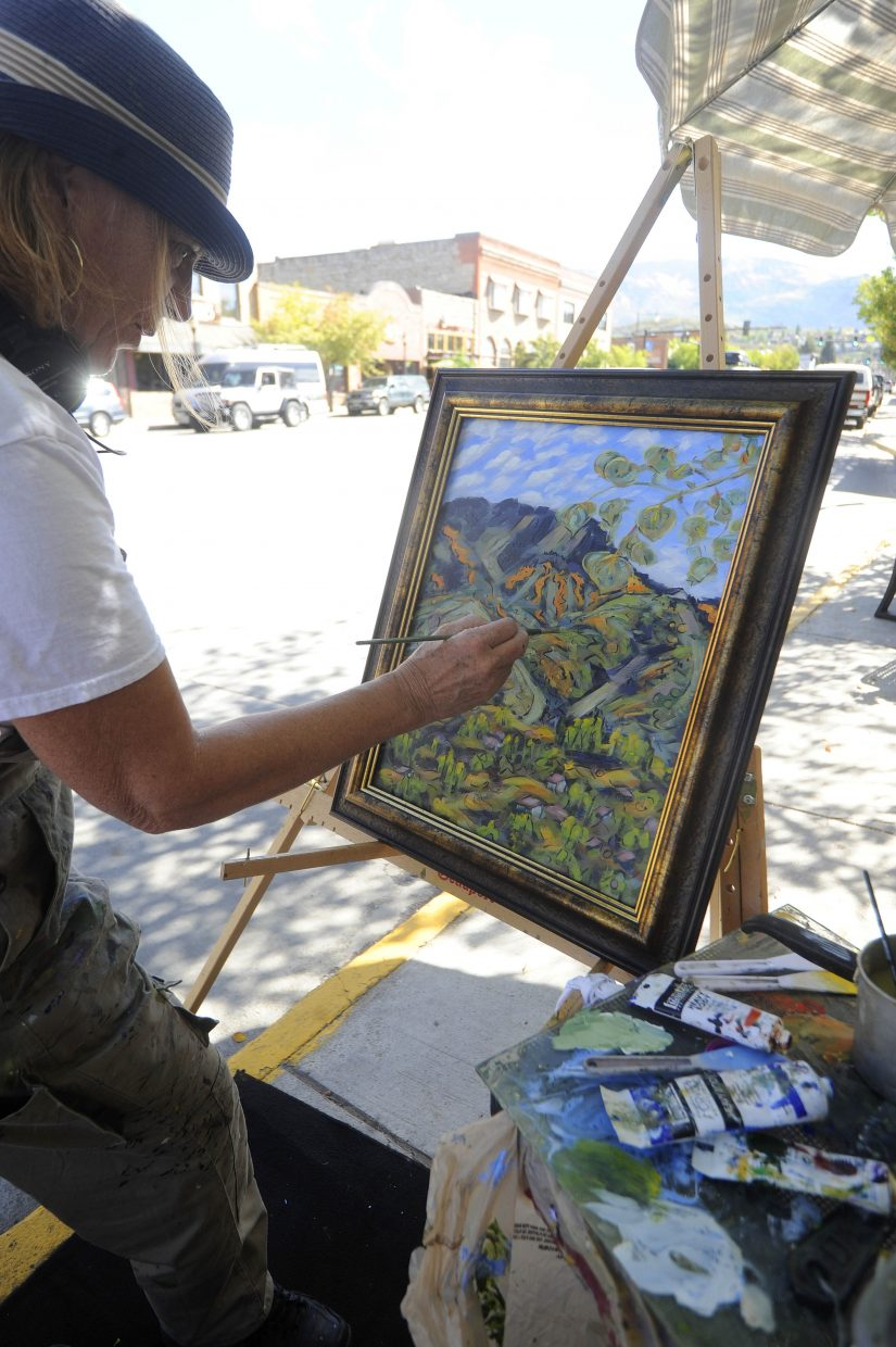 Steamboat Springs artist Jaen Carol works on her painting downtown Saturday during the Steamboat Art Museum's plein air painting Quick Draw event.