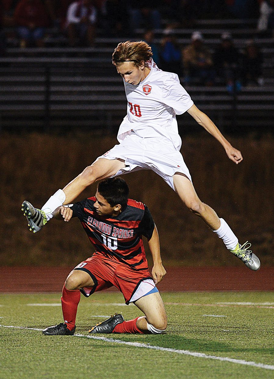 Steamboat Springs junior Jason Oehme goes high to avoid a collision with Glenwood Springs' Jon Vazquez after the midfield used a slide tackle to clear the ball on a play in the second half of Tuesday's game at Gardner Field. Oehme avoided the collision as the Sailors went on to win the game 7-0.