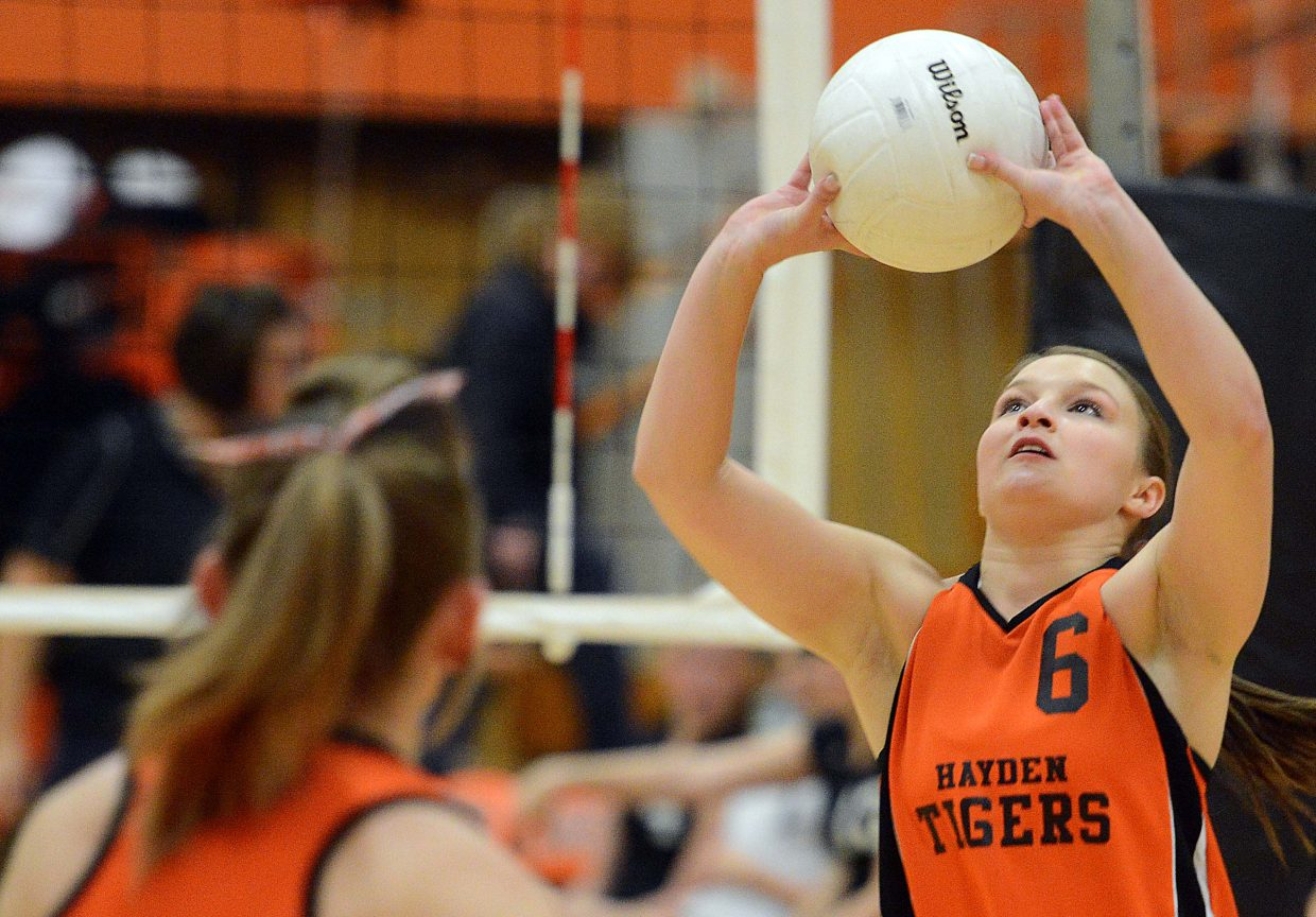 Olivia Zehner sets the ball Saturday against Rangely. Zehner did it all for the Tigers, setting, hitting well, blocking and coming through with seven consecutive good serves to help the team out of a 24-19 final-set hole.