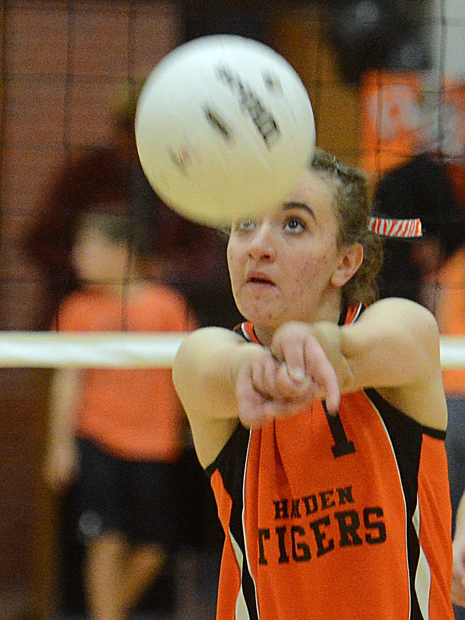 Becca Hoza bumps the ball Saturday against Rangely.