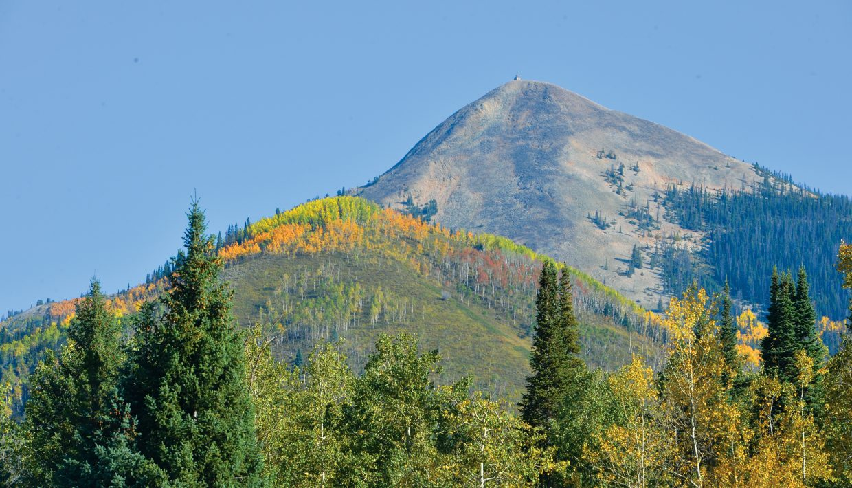 The colors around Hahn's Peak in North Routt County are already starting to fade, but the majestic peak still stands out against a bright blue mountain sky.