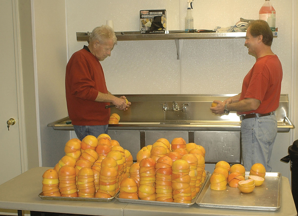 Ken Nelson, left, and Darrel Philmon scoop the pulp out of citrus shells at Steamboat's Fixins Kitchen in 2011. As some businesses report a hard time finding kitchen space here, some local organizations are working to determine the supply and demand of commercial kitchen space in Steamboat.