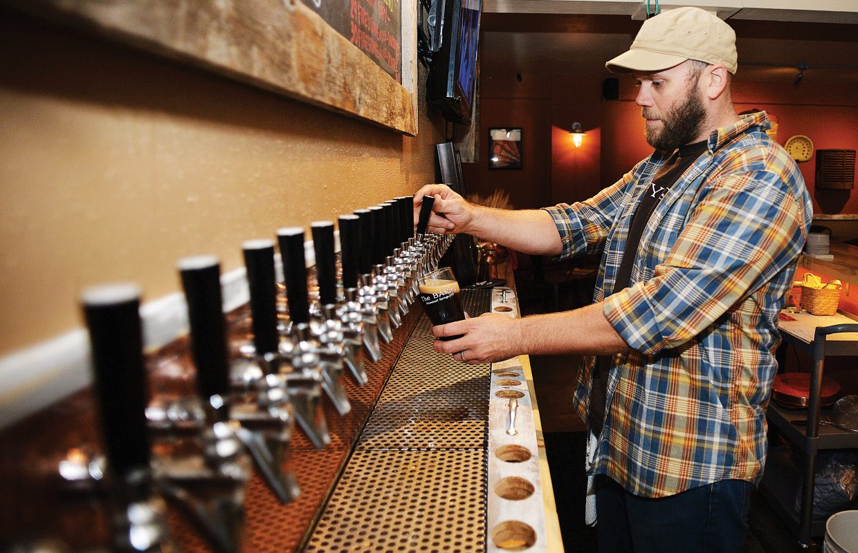 Bartender Michael Ruby draws a beer at The BARley: Colorado Craft & Draft, located in Old Town Square in downtown Steamboat Springs. The local bar opened about a month ago and features a huge selection with 30 beers on tap.