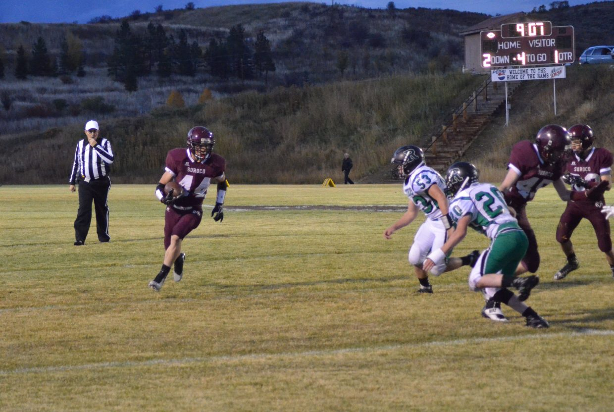 Soroco sophomore running back Jace Logan swings around a pair of Rangely defenders on his way to the first of five touchdowns he scored during Soroco's 54-0 homecoming drubbing of Rangely.