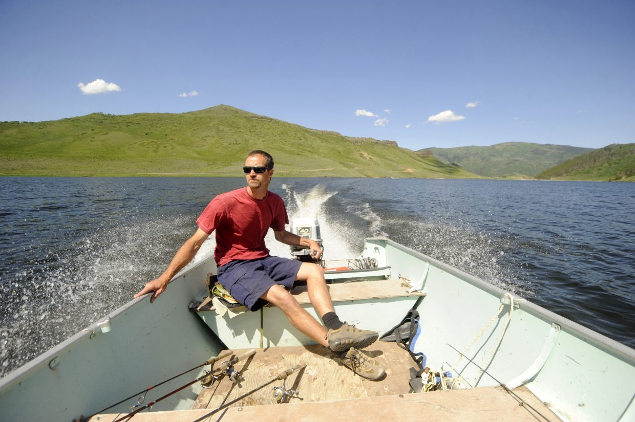 Pike fisherman Preston cruises to one of his favorite fishing spots June 12 at Stagecoach Reservoir.