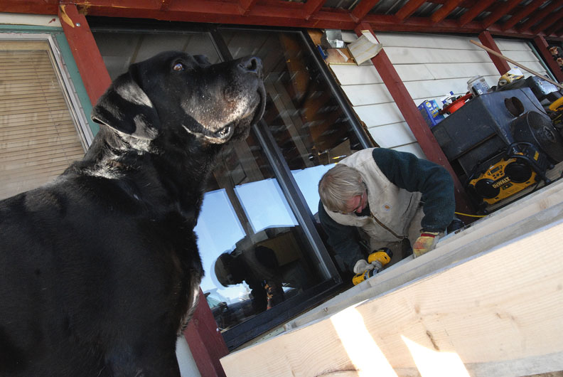 Todd Bellio works on the deck. The door into the bedroom had a step, so Bellio created a platform for Elizabeth Perschon to turn on.