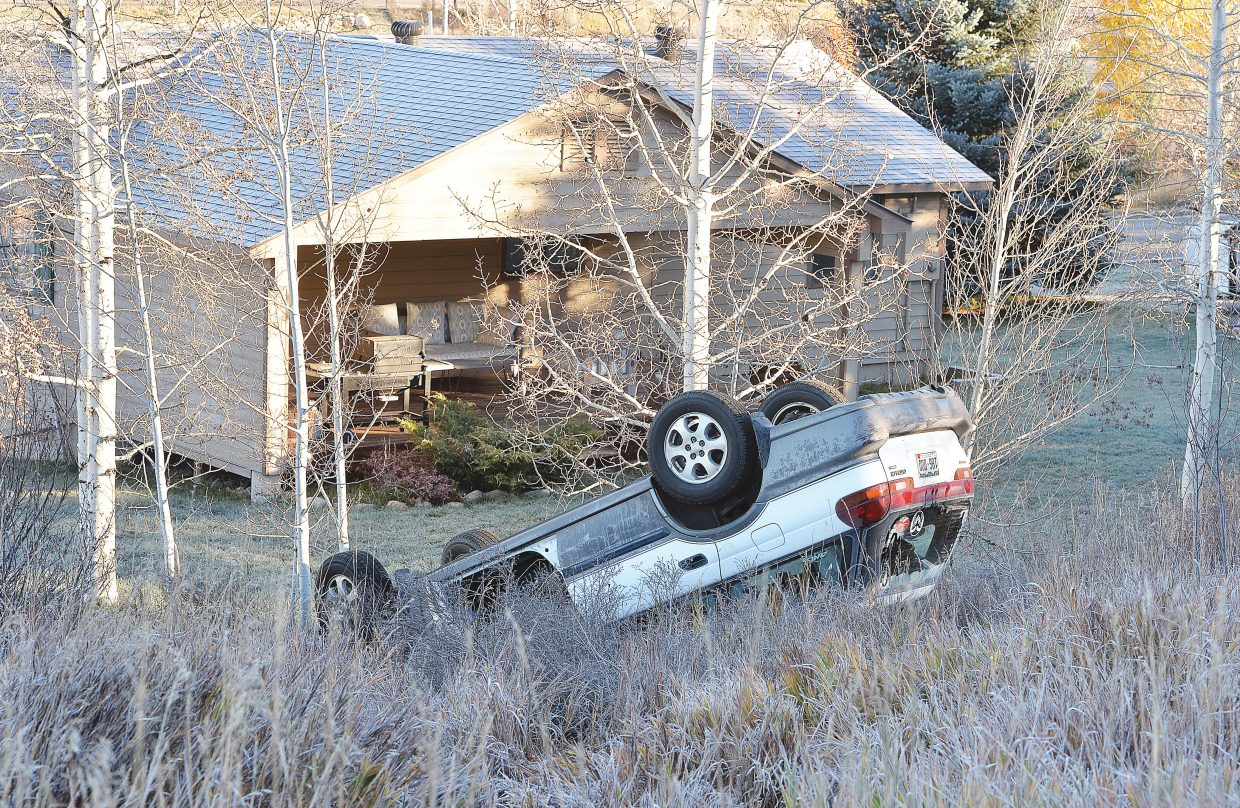 A Subaru Outback sits on its roof just off of Fish Creek Falls Road on Tuesday morning after the driver apparently lost control of the vehicle and over-corrected. The car left the roadway, rolled and ended up near the backyard of a home on Amethyst Drive. The driver was wearing a seat belt, and there were no injuries in the accident.