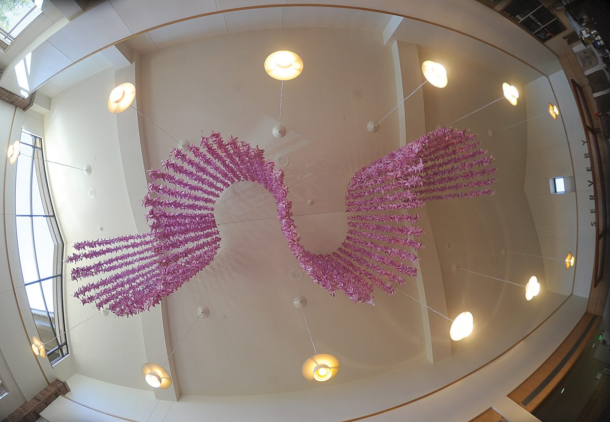 """Local artist Kim Keith created """"Bent Doves Flying,"""" an elevated art installation containing 7,000 origami doves hanging from the ceiling at the Yampa Valley Medical Center, to help Advocates Building Peaceful Communities. The doves, which were folded by community members, business owners and survivors, represent the more than 7,000 survivors who have been assisted by Advocates the past 30 years. October is National Domestic Violence Awareness Month and the local Advocates organization is celebrating 30 years of service to the community. The Yampa Valley Medical Center will be hosting a reception honoring Advocates and the art installation from 4 to 6 p.m. Tuesday with refreshments."""