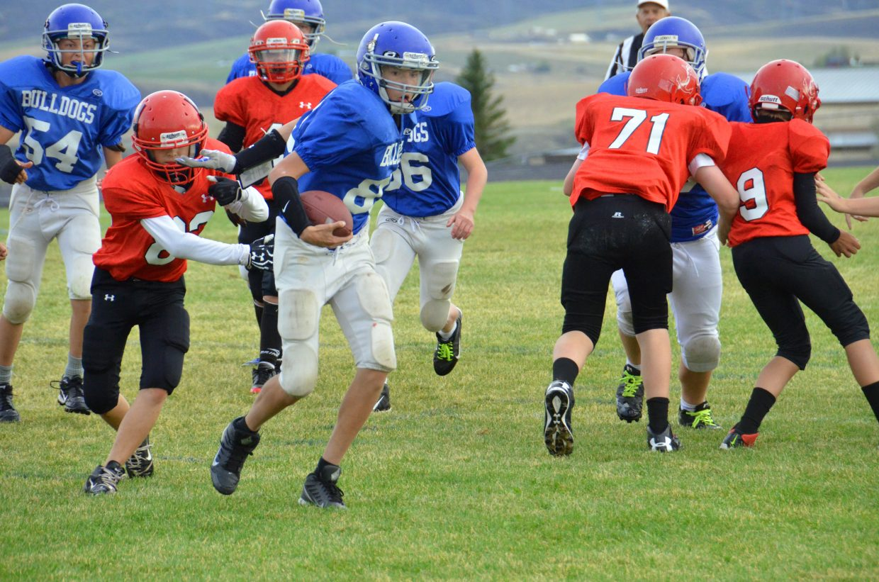 Craig Middle School seventh-grade quarterback Caleb Cuevas gains some yardage near the end zone during the Bulldogs' Tuesday night games against Steamboat Springs. Both CMS teams defeated the Sailors.